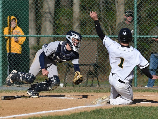 Pocomoke catcher Jared Hancock goes for the tag on