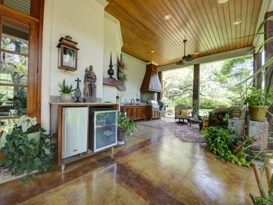There are beautiful outdoor living and cooking spaces.