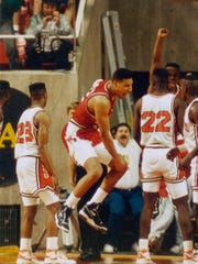 Ball State celebrates upsetting Oregon State in the opening round of the 1990 NCAA Tournament on the way to the Sweet 16.
