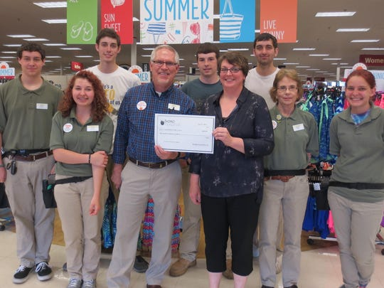 The Campbellsport Public Library received a $200 grant from The Shopko Foundation for the Library's 2015 Summer Reading Program. Director Stephanie Grigg-Remillard accepted the donation from some of Shopko's employees.