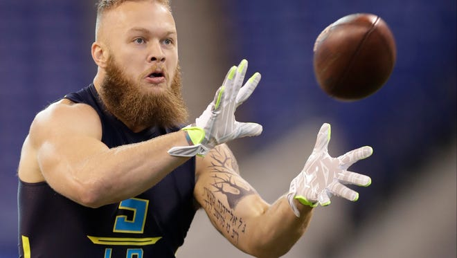 Clemson linebacker Ben Boulware catches a throw in a drill at the NFL Scouting Combine on Sunday.