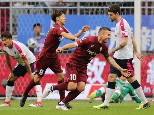 Vissel Kobe's Lukas Podolski (10) celebrates after scoring a goal against Cerezo Osaka during their J-League season soccer match in Kobe, western Japan, Sunday, March 18, 2018. Kobe won 2-0. (Kyodo News via AP)