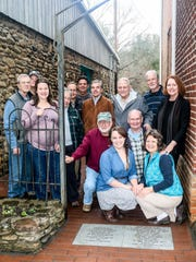 Making the alley possible are museum staff, board members, architects and contractors John Buckner (standing, left to right), Bill Hamby, Anne Chesky Smith, Yolanda Smith, Peter Looper, John Ewing, John Fisher, John Corkran, Jim McConnaughy, Carol Tyson, Jack Jones (sitting, left to right), Katherine Cutshall, Bill Alexander and Sally Biggers.