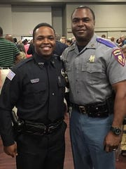 Kenny Barron stands with his father, Kenneth Barron, at his graduation from Mississippi Law Enforcement Officer's Training Academy.