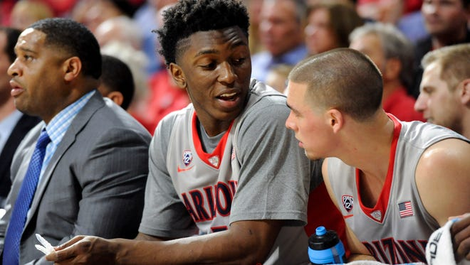 Dec. 2, 2014; Tucson; Arizona Wildcats forward Stanley Johnson (5) talks to guard T.J. McConnell (4) during the second half against the Gardner Webb Bulldogs at McKale Center.