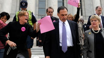 Lehman Brothers Holdings Inc. Chief Executive Richard S. Fuld Jr., wearing tie, is heckled by protesters as he leaves Capitol Hill in Washington after testify before the House Oversight and Government Reform Committee Monday, Oct. 6, 2008, on the collapse of Lehman Brothers. (AP Photo/Susan Walsh) ORG XMIT: DCSW114