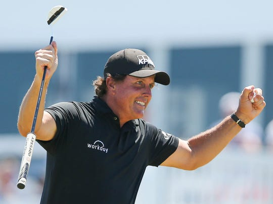 Phil Mickelson celebrates on the 13th green during the final round of the U.S. Open golf tournament at Shinnecock Hills on June 17.