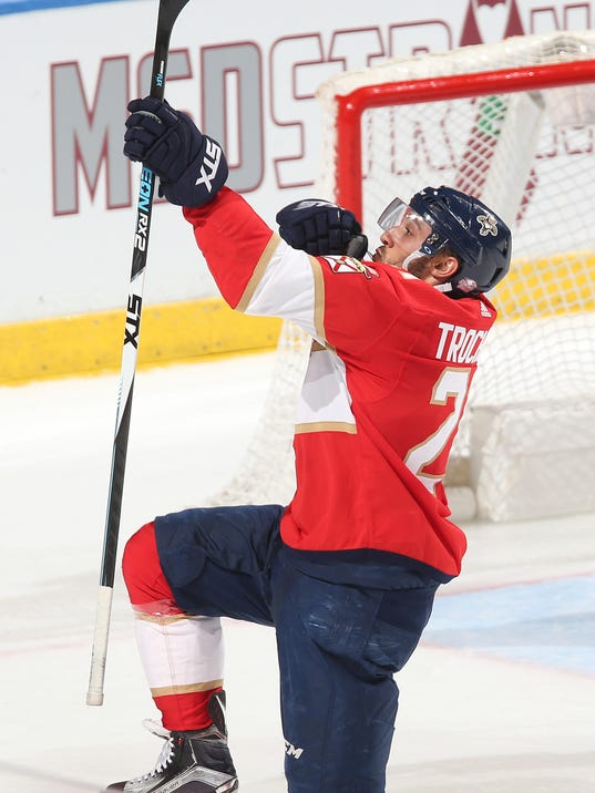 Florida Panthers center Vincent Trocheck (21) celebrates after scoring the wining goal against the Washington Capitals during the third period of an NHL hockey game, Thursday, Feb. 22, 2018, in Sunrise, Fla. (AP Photo/Joel Auerbach)