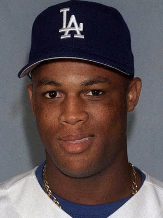 FILE - This is a 1999 file photo showing Adrian Beltre of the Los Angeles Dodgers baseball team. Beltre, who got his 3,000th career hit last season, is going into his 21st MLB season. This is the third baseman's eighth season with the Rangers, the fourth organization he has been with. He started his MLB career in 1998 as a 19-year-old with the Dodgers. He is one of only two current MLB players who have played at least 20 seasons. (AP Photo/File)