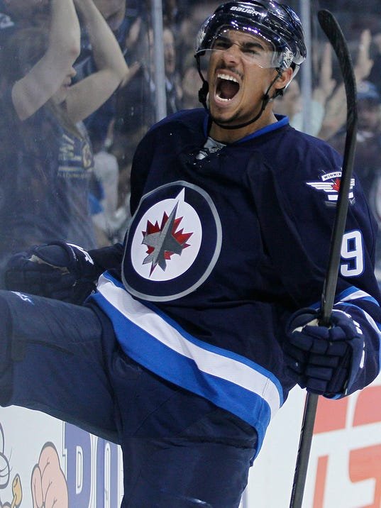 Winnipeg Jets' Evander Kane (9) celebrates his goal against the Colorado Avalanche during second period NHL action in Winnipeg on Wednesday, March 19, 2014. THE CANADIAN PRESS/John Woodsduring the second period of an NHL hockey game Wednesday, March 19, 2014, in Winnipeg, Manitoba. (AP Photo/The Canadian Press, John Woods)