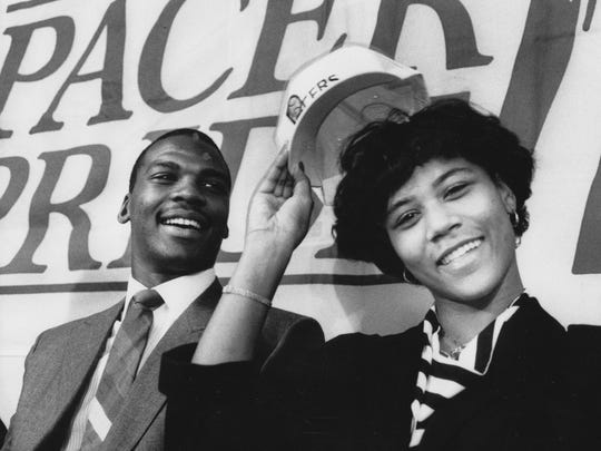 Chuck Person and wife, Kimberley, bask in the limelight during his signing with the Pacers at Market Square Arena, Sept. 15, 1986.