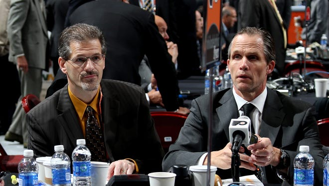 PHILADELPHIA, PA - JUNE 28:  Chris Pryor, Director of Scouting (R), and Ron Hextall General Manager of the Philadelphia Flyers (L) sit at their team table on Day Two of the 2014 NHL Draft at the Wells Fargo Center on June 28, 2014 in Philadelphia, Pennsylvania.  (Photo by Bruce Bennett/Getty Images)