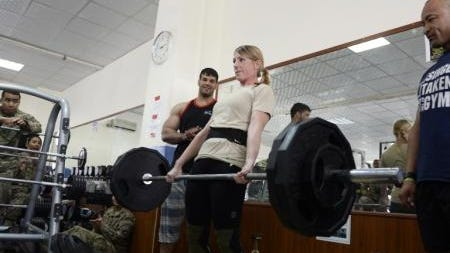Air Force Capt. Lori Fiorello, from Morristown, completes a dead lift after a fitness clinic and strength competition with coalition troops in Kabul, Afghanistan.