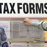 Taxpayers search through tax forms at the Illinois Department of Revenue in Springfield, Ill., Thursday, April 15, 2010.
