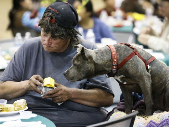 A guest and her dog are served a meal during Salvation
