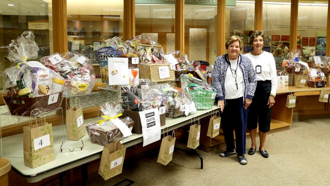BDCH Partners Ramona Ross, left, and Betty Michael, pose next to gift baskets which will be raffled during the Oct. 3 BDCH Craft Fair.