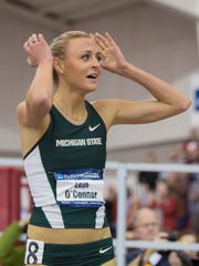 Michigan State's Leah O'Connor reacts after setting a meet record in the mile the NCAA indoor track and field championships Saturday, March 14, 2015, in Fayetteville, Ark. (AP Photo/Gareth Patterson)
