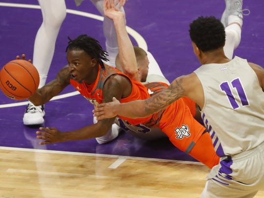 Texas Rio Grande Valley's Javon Levi (14) recovers a loose ball and passes as he falls against GCU during the second half at Grand Canyon University Arena in Phoenix, Ariz. on February 7, 2019.