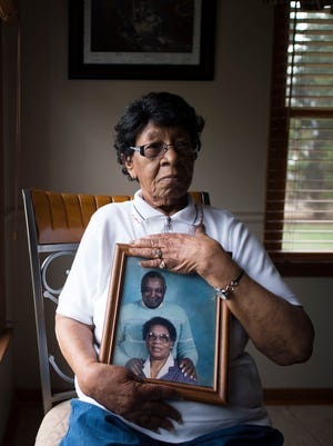 Minnie B. Singletary holds a photo of her late husband, Franklin Singletary, in her son, Benjamin's, home in Dagsboro.