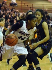 Pineville's Danyale Bayonne (42, left) takes the ball