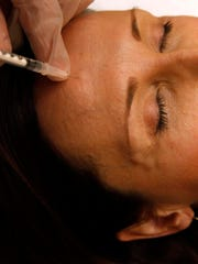Colleen Delsack receives a Botox injection