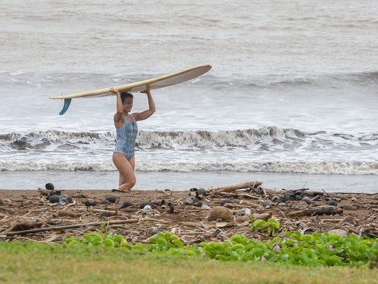 635880661221378056-Wild-0107-surfer.jpg