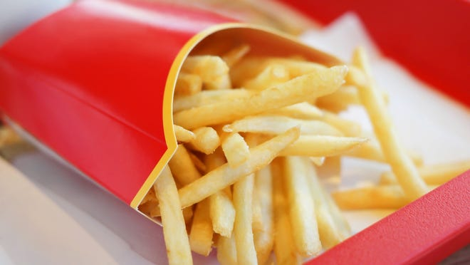 Fast-food french fries in a red carton.
