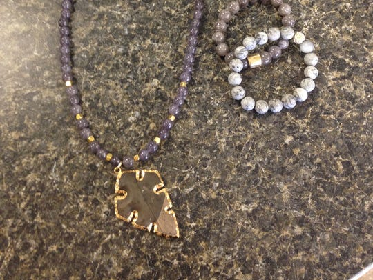 Accessorize your holiday look with stone necklaces,