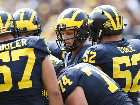 Wolverines, michigan offensive line, mason cole, michigan huddle