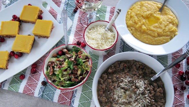 A special meal prepared for loved ones includes (clockwise from left) Meyer lemon bars, pomegranate sparklers, creamy polenta,  Bolognese sauce with porcini mushrooms and brussels sprouts and cranberries.