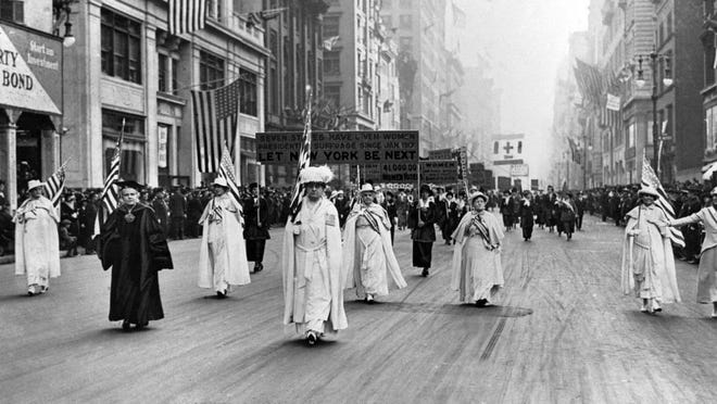 Dr. Anna Shaw and Carrie Chapman Catt, founder of the League of Women Voters, lead an estimated 20,000 supporters in a women's suffrage march on New York's Fifth Ave. in 1915. Associated Press photo