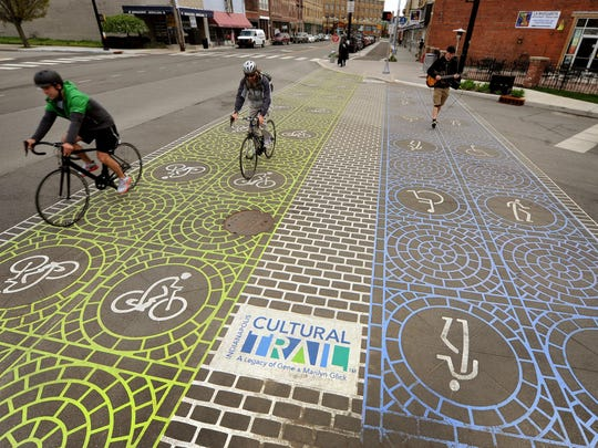 Bicyclists use the Indianapolis Cultural Trail along Virginia Avenue at the edge of Fountain Square.