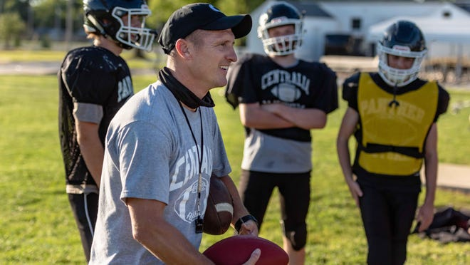 Centralia head football coach Tyler Forsee talks to his players while they take a quick break during preseason practice Wednesday at Centralia High School.
