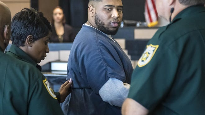 """Shamar Lawrence says """"I love you, man"""" to family members as he is led from the courtroom Tuesday, September 24, 2019 after being sentenced to 45 years in prison for the June 2016 murder of 17-year-old Branden Jackson in The Acreage."""