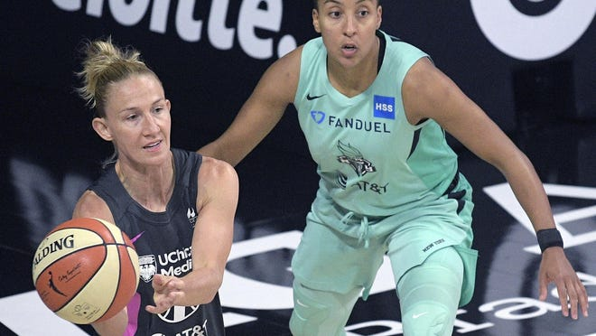 Chicago Sky guard Courtney Vandersloot (22) passes the ball in front of New York Liberty guard Layshia Clarendon.