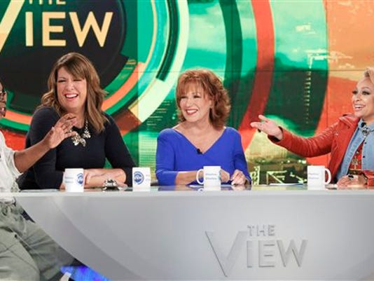 """In this Sept. 9, 2015 photo released by ABC, co-hosts, from left, Whoopi Goldberg, Michelle Collins, Joy Behar and Raven-Symone appear on the daytime talk show, """"The View,"""" in New York."""
