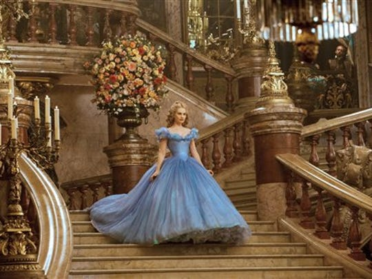 Lily James as Cinderella makes her entrance to the ball in Disney's live-action fairy tale, Cinderella.