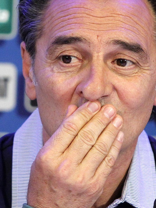 Italy coach Cesare Prandelli listens reporters' questions during a press conference at Coverciano training complex, in Florence, Italy, Tuesday, May 20 , 2014,   Italy opened its World Cup training camp Monday with 31 players.  Prandelli needs to trim his squad to 23 players by June 2.  In Brazil, Italy is in Group D with England, Uruguay and Costa Rica. (AP Photo/Fabrizio Giovannozzi)