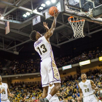 Tanksley Efianayi goes up for a lay up in a UCF men's