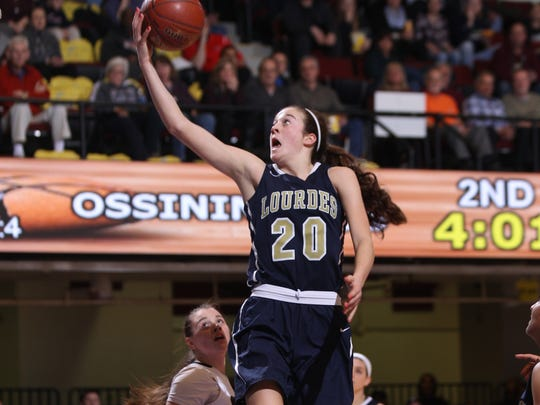 Lourdes' Madison Seigrist (20) puts up a shot during the first half of play in the Section 1 Class AA girls semifinal basketball game at the Westchester County Center in White Plains on Thursday, March 2, 2017.