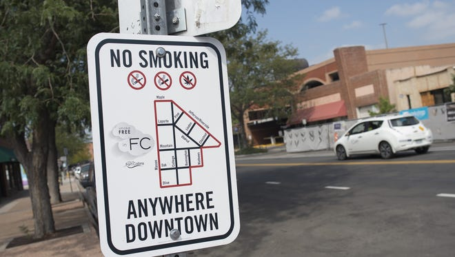 Signage on Remington Street displays the boundaries of the Downtown Smoke-Free Zone.