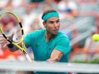 Rafael Nadal of Spain goes up to the net to return to Daniel Evans of Britain during the Rogers Cup men's tennis tournament Wednesday, Aug. 7, 2019, in Montreal. (Paul Chiasson/The Canadian Press via AP)