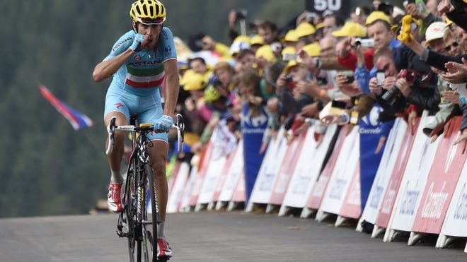 Italy's Vincenzo Nibali sprints to win the 161.50 km tenth stage of the 101st edition of the Tour de France on Monday.