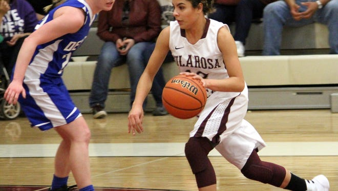 Cassie Vickery drives towards the basket Tuesday night at the Michael Dorame Gymnasium.