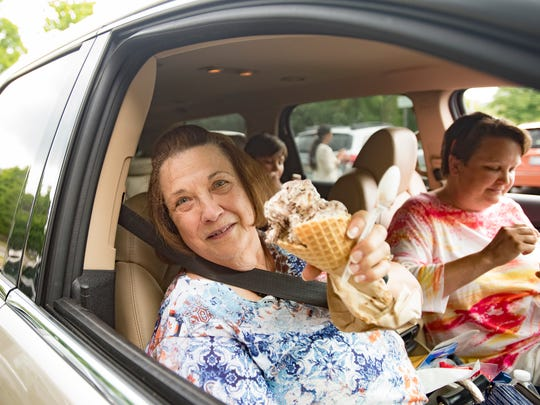 """Addie Mutch of Clarkston show her ice cream cone purchased from the MSU Dairy Store, Tuesday, July 24, 2018.  Also pictured is daughter Misty.  """"We stop at the MSU Dairy Store for ice cream whenever we're in the area,"""" Misty said."""