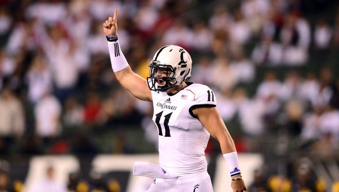 Cincinnati Bearcats quarterback Gunner Kiel (11) celebrates after a touchdown during the second quarter against the Toledo Rockets at Paul Brown Stadium.