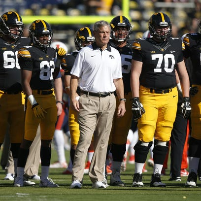 Iowa head football coach Kirk Ferentz watches over