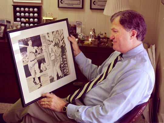 Clay Ambrose and his autographed photo display of the late Joe DiMaggio in 1999.