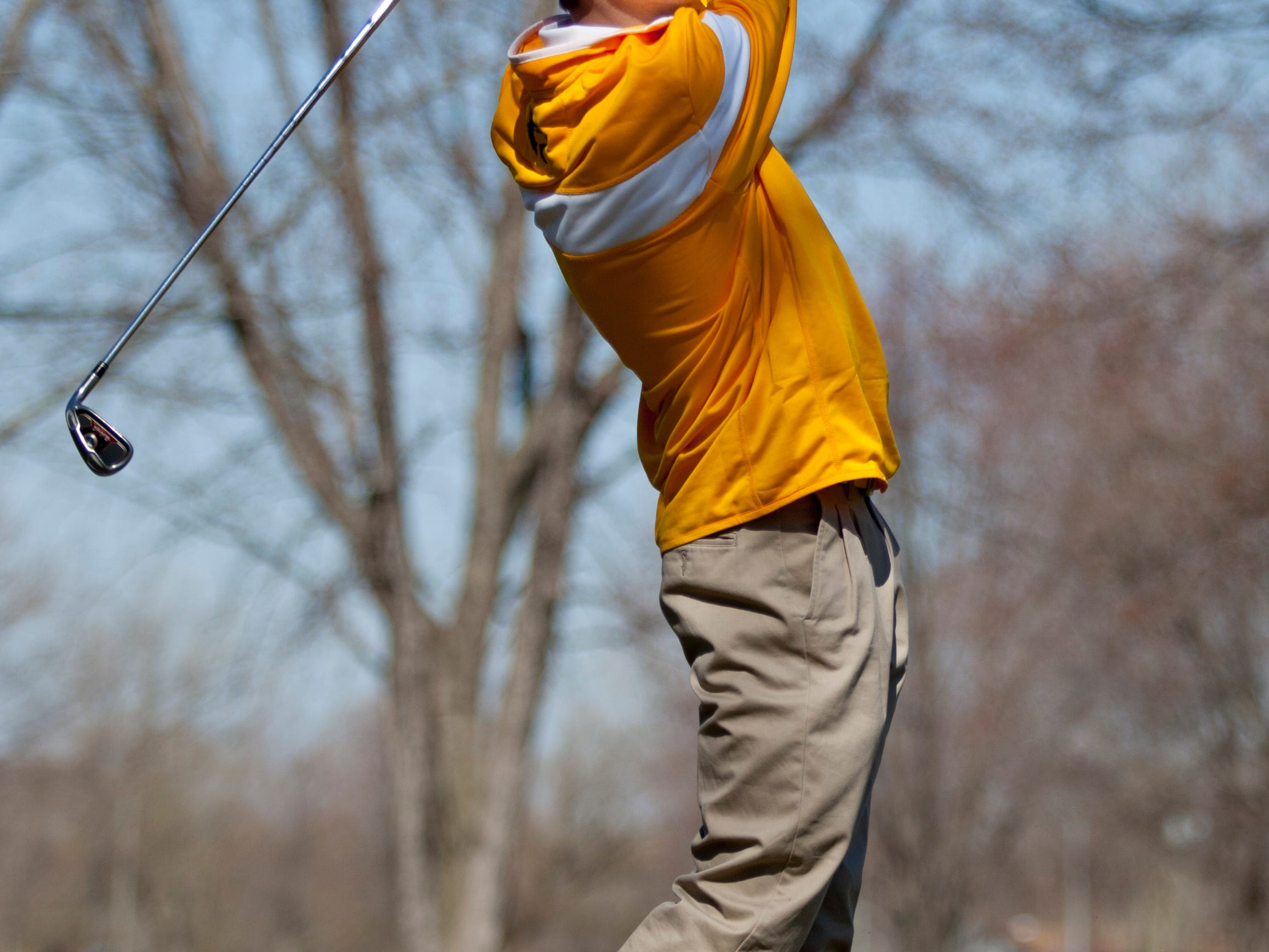 Port Huron Northern sophomore Kurtis Obermyer, 16, takes a shot from the fairway Friday, April 17, 2015 at the Port Huron Elks Golf Club in Port Huron Township.