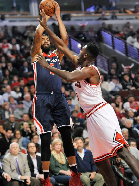 Washington Wizards' Markieff Morris (5), goes up for a shot against Chicago Bulls' Bobby Portis (5), during the first half of an NBA basketball game Wednesday, Feb. 24, 2016, in Chicago. (AP Photo/Paul Beaty)